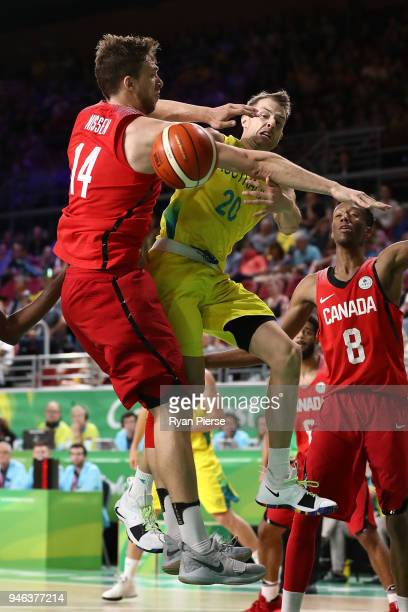 Australia guard Nathan Sobey and Canada center Erik Nissen compete during the Men's Gold Medal Basketball Game between Australia and Canada on day 11...