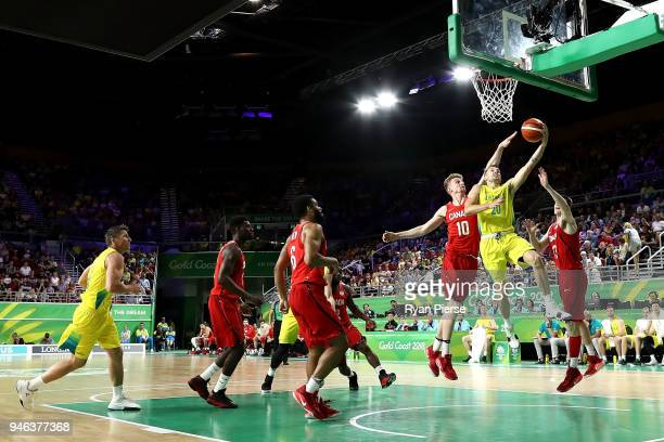 Australia guard Nathan Sobey and Canada center Grant Shephard compete during the Men's Gold Medal Basketball Game between Australia and Canada on day...