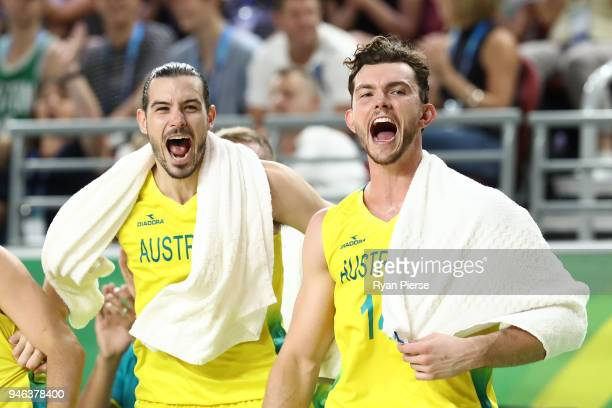 Australia guard/forward Chris Goulding and Australia forward Angus Brandt celebrate during the Men's Gold Medal Basketball Game between Australia and...