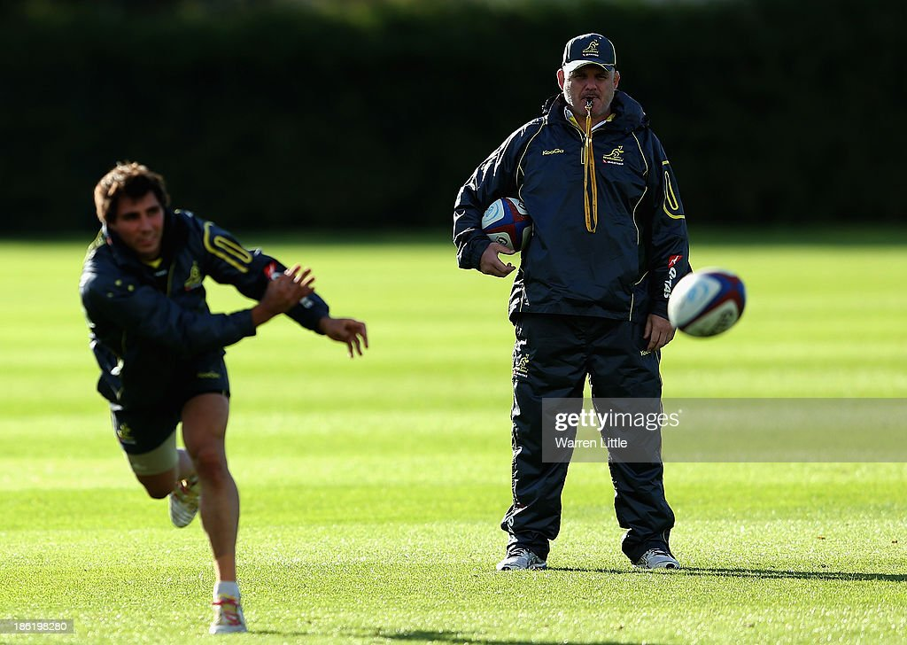 Australia head coach Ewen McKenzie keeps an eye on training at the Latyrmer School on October 29, 2013 in London, England.