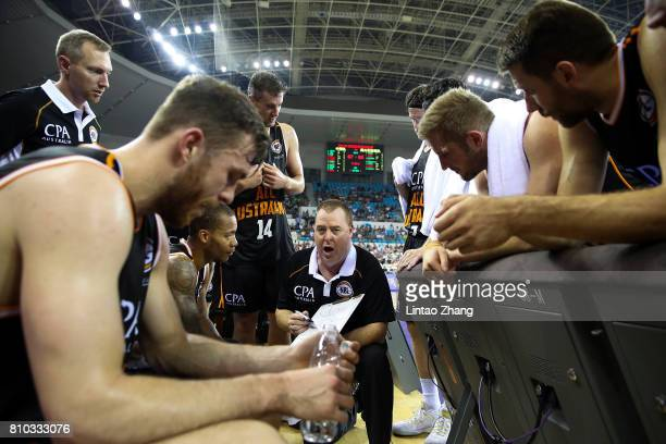Australia head coach Rob Beveridge addresses his players at a timeout during the 2017 SinoAustralia Men's International Basketball Challenge at Jilin...
