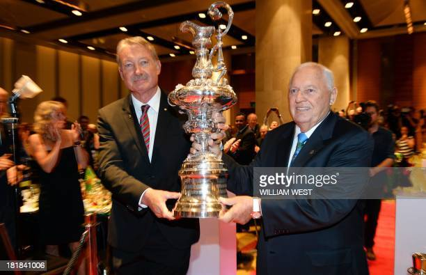 Australia II skipper John Bertrand and owner Alan Bond present a replica of the America's Cup they won at a luncheon to celebrate the 30th...