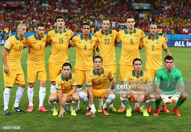 Australia line up for a team photo before the 2014 FIFA World Cup Brazil Group B match between Chile and Australia at Arena Pantanal on June 13 2014...