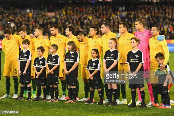 Australia line up for the national anthem during the Brazil Global Tour match between Australian Socceroos and Brazil at Melbourne Cricket Ground on...