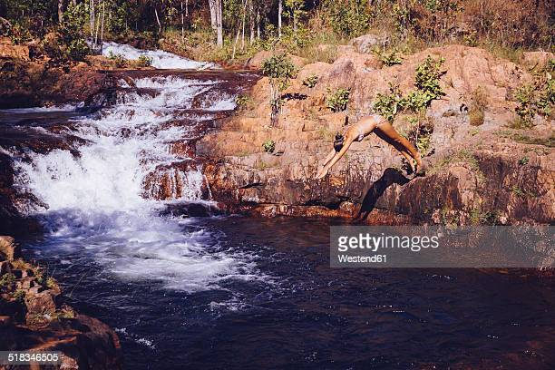 Australia, Litchfield National Park, Woman relaxing at Buley Rockhole