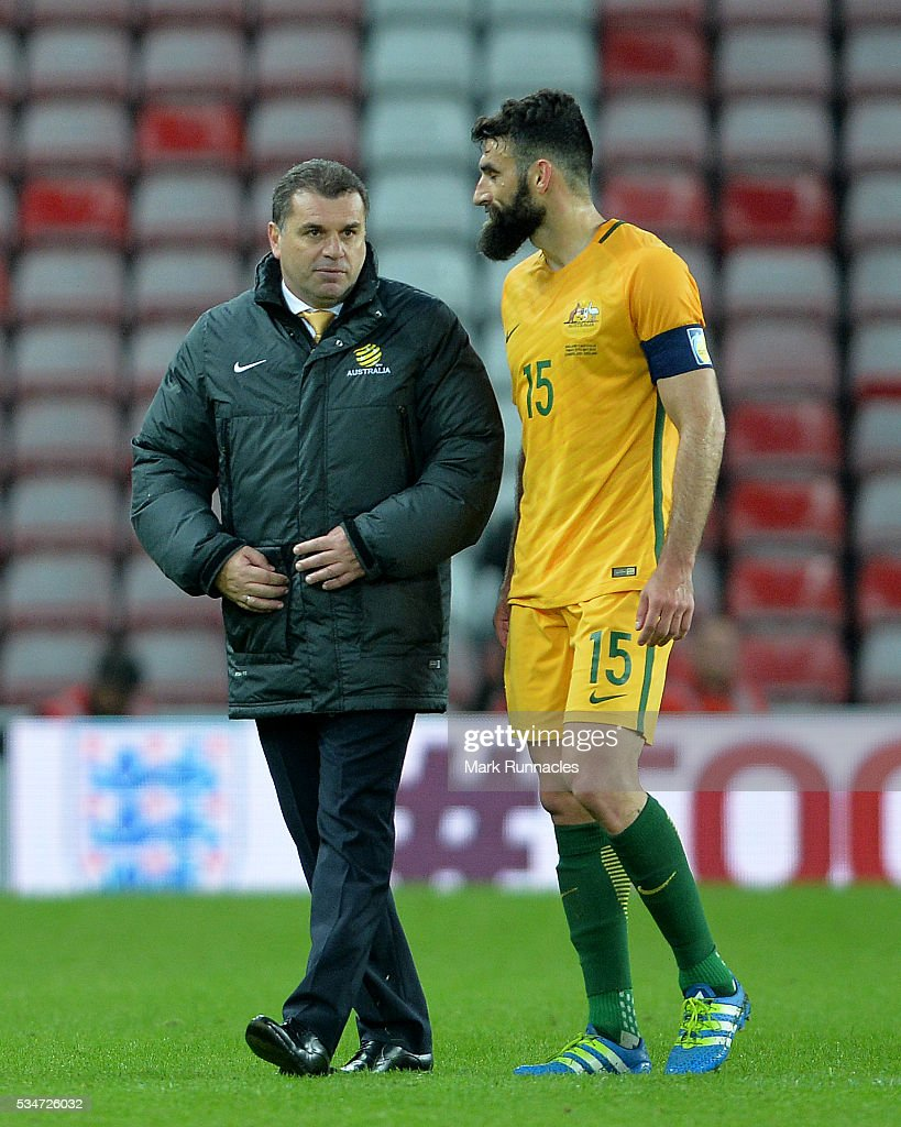 Australia manager Ange Postecoglou talk to Mile Jedinak at the final whistle during the International Friendly match between England and Australia at Stadium of Light on May 27, 2016 in Sunderland, England.