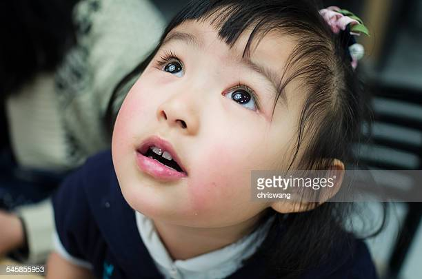 Australia, Melbourne, Headshot of young girl looking up