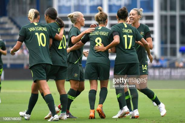 Australia midfielder Tameka Butt celebrates with teammates after scoring a goal in game action during a Tournament of Nations match between Brazil v...