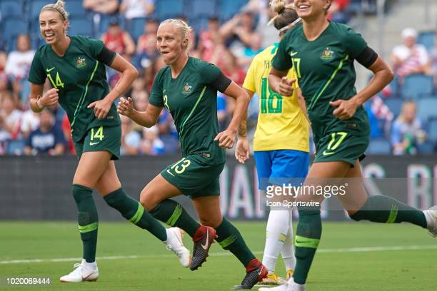 Australia midfielder Tameka Butt celebrates with teammates after scoring a goal in game action during a Tournament of Nations match between Brazil vs...