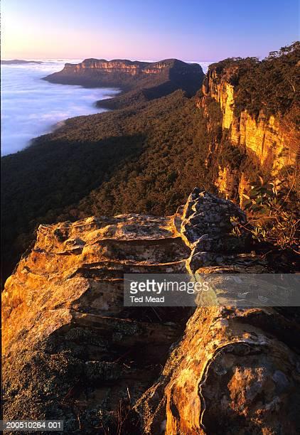 Australia, mist in Jamison Valley below escarpment and Mt. Solitary