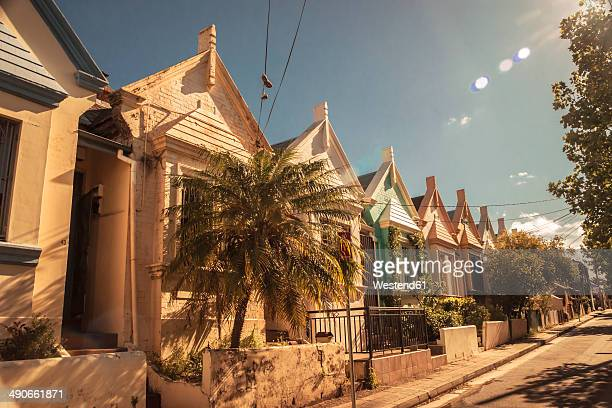 Australia, New South Wales, Sydney, Newtown, row of old residential houses at sunlight