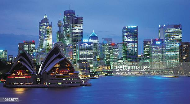 australia, new south wales, sydney, opera house and skyline, dusk - peter adams stock pictures, royalty-free photos & images