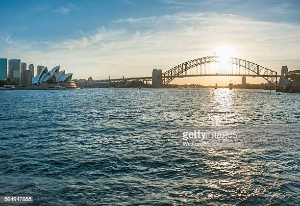 Australia, New South Wales, Sydney, Skyline with Sydney Harbour Bridge and Sydney Opera House at sunset