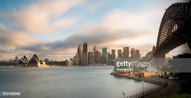 australia, new south wales, sydney, skyline with sydney opera house and sydney harbour bridge - オペラ座 ストックフォトと画像