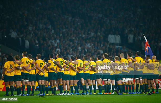 Australia observe the national anthem during the 2015 Rugby World Cup Pool A match between England and Australia at Twickenham Stadium on October 3...