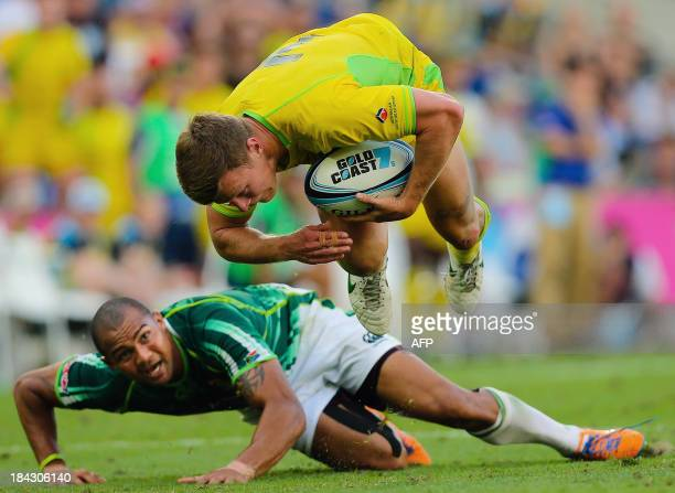 Australia player Cameron Clarke gets airborne after beating the tackle of South Africa player Cornal Hendricks during a semi final match between...