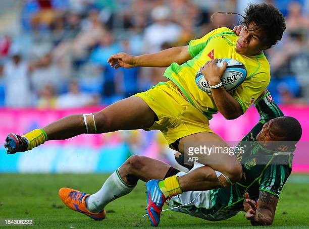 Australia player Junior Laloifi is tackled by South Africa player Cornal Hendricks during a semi final match between Australia and South Africa at...
