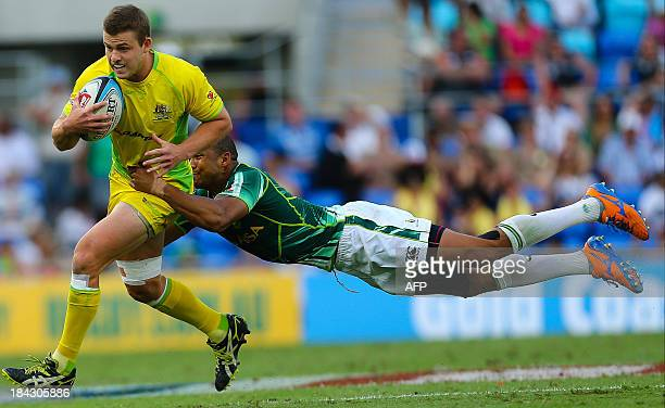Australia player Nick Malouf is tackled by South Africa player Cornal Hendricks during their semi final match between New Zealand and England at the...