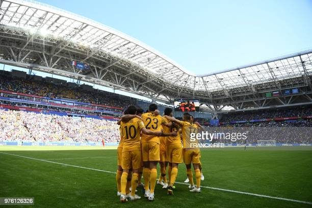 Australia players celebrate a goal after a penalty kick during the Russia 2018 World Cup Group C football match between France and Australia at the...