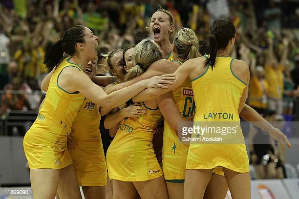 Australia players celebrate after defeating New Zealand in the 2011 World Netball Championships final at Singapore Indoor Stadium on July 10, 2011 in...