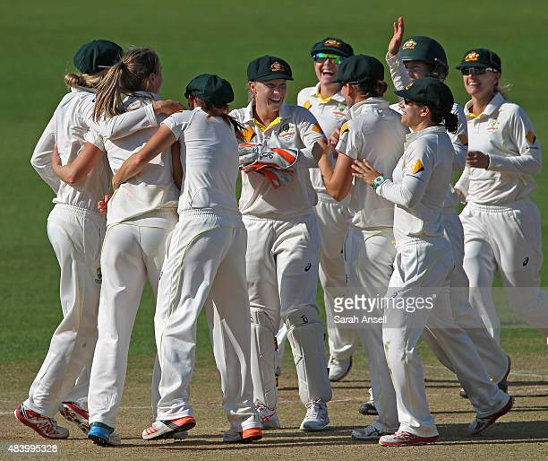 Australia players celebrate after Ellyse Perry dismisses Lydia Greenway during day four of the Kia Women's Test of the Women's Ashes Series between...