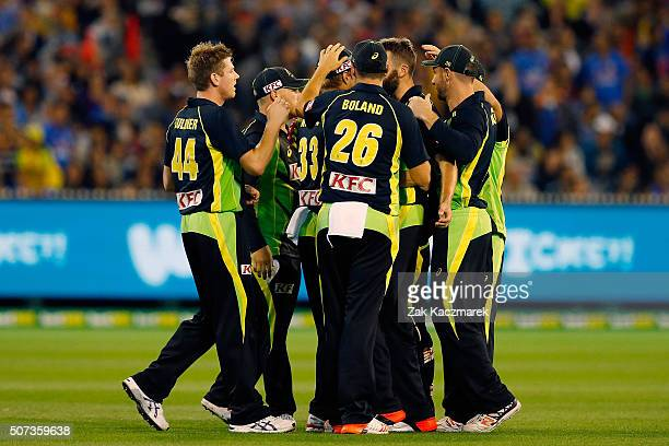 Australia players celebrate after MS Dhoni is dismissed caught by Shane Watson during the International Twenty20 match between Australia and India at...