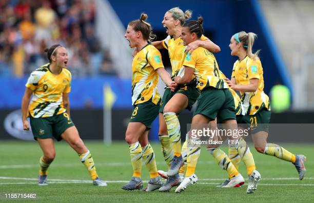 Australia players celebrate after their team's third goal an own goal by Monica of Brazil during the 2019 FIFA Women's World Cup France group C match...