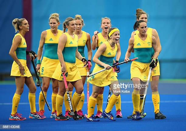 Australia players celebrate as Jodie Kenny of Australia scores a penalty stroke goal during the Women's Pool B Match between India and Australia on...