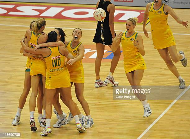 Australia players celebrate their win at the close of the Mission Foods World Netball Championships Final match between Australia and New Zealand at...