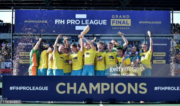 Australia players celebrate victory after the Men's FIH Field Hockey Pro League Final between Belgium and Australia at Wagener Stadium on June 30,...