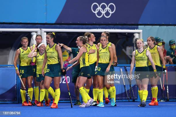 Australia players celebrate victory following the Women's Preliminary Pool B match between Japan and Australia on day five of the Tokyo 2020 Olympic...