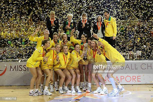 Australia players celebrate with the trophy after their victory in the final against New Zealand during the 2011 World Netball Championships at...