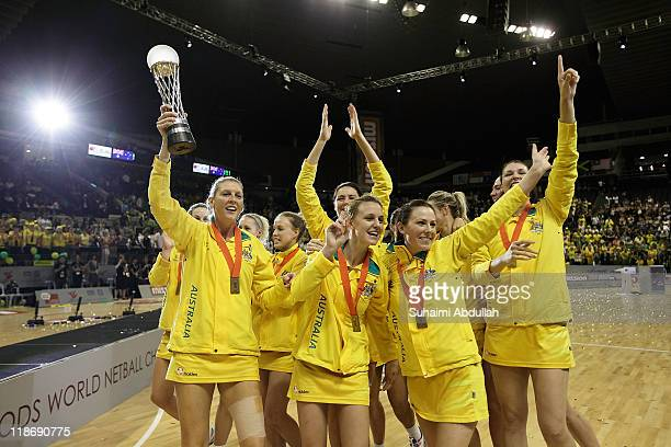 Australia players celebrate with the trophy after their victory against new Zealand in the finals of the 2011 World Netball Championships at...