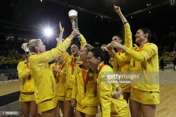 Australia players celebrate with their trophy after defeating New Zealand in the 2011 World Netball Championships final at Singapore Indoor Stadium...