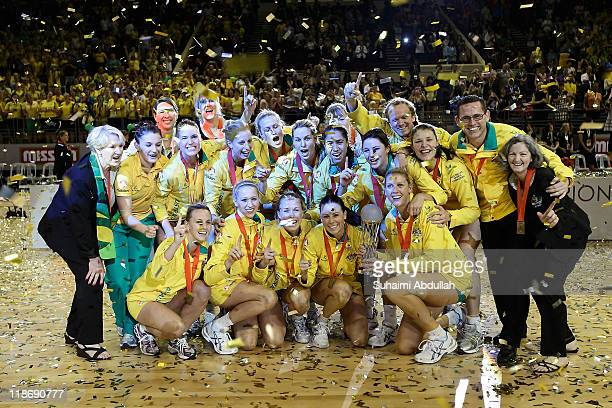 Australia players celebrate with their trophy after their victory against New Zealand in the final of the 2011 World Netball Championships at...