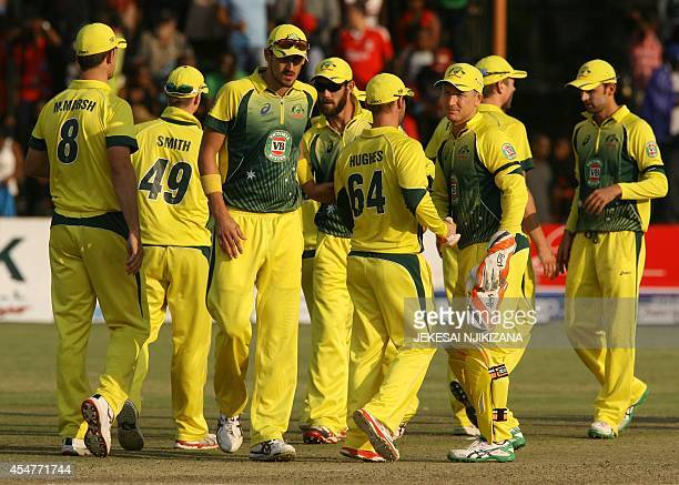 Australia players gather on September 6 2014 after South Africa won the oneday international triangular series final at the Harare Sports Club...