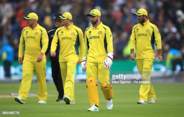 Australia players leave the pitch because of rain during the ICC Champions Trophy Group A match at Edgbaston Birmingham