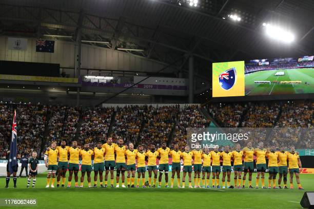 Australia players line up for the national anthem prior to the Rugby World Cup 2019 Group D game between Australia and Fiji at Sapporo Dome on...