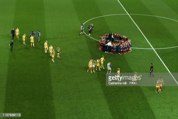 Australia players look dejected as the Norway players form a team huddle following Norway's victory in the penalty shoot out during the 2019 FIFA...