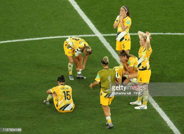 Australia players look dejected following their defeat in the penalty shoot out during the 2019 FIFA Women's World Cup France Round Of 16 match...