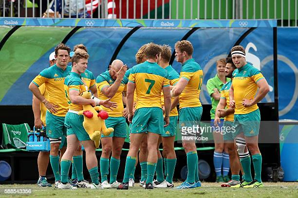 Australia players look dejected in defeat after the Men's Rugby Sevens placing 58 match between Argentina and Australia on Day 6 of the Rio 2016...