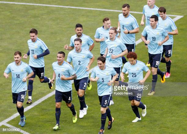 Australia players run during training at Saitama Stadium in Saitama north of Tokyo on Aug 30 a day before a World Cup qualifier against Japan ==Kyodo
