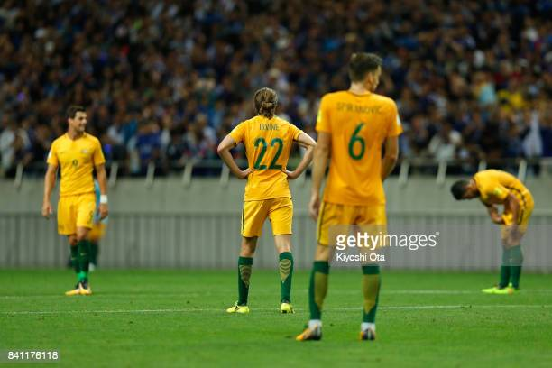 Australia players show dejection after Japan's second goal during the FIFA World Cup Qualifier match between Japan and Australia at Saitama Stadium...
