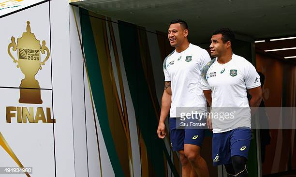 Australia players Will Genia and Israel Folau share a joke as they make their onto the field during the Australia Captain's Run ahead of the World...
