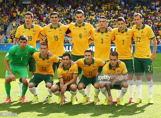 Australia pose for a team photo prior to the 2014 FIFA World Cup Brazil Group B match between Australia and Spain at Arena da Baixada on June 23 2014...