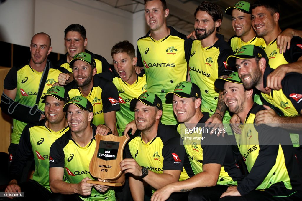 Australia pose with the T20 Tri Series Trophy following the International Twenty20 Tri Series Final match between New Zealand and Australia at Eden Park on February 21, 2018 in Auckland, New Zealand.