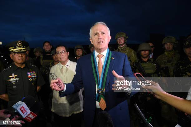 Australia Prime Minister Malcolm Turnbull talks to Philippines and Australian troups during a visit at a military headquarters in Quezon City near...