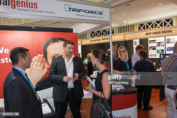 Australia Queensland Brisbane Central Business District Adelaide Street Brisbane City Hall digital business expo exhibitor man woman talking...