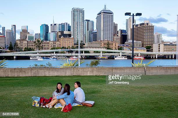 Australia Queensland Brisbane Central Business District city skyline skyscrapers buildings Southbank park Asian woman friends Pacific Motorway M3...