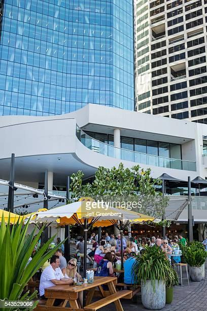 Australia Queensland Brisbane Central Business District Eagle Street Pier Riverside Center restaurant umbrellas alfresco dining high rise buildings...